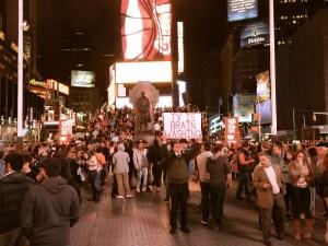 New York, 12 octobre 2014, Times Square, un agent de changement solitaire